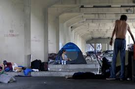 living hand to mouth in modern american poverty on point homeless people stay their belongings under the pontchartrain expressway overpass in new orleans wednesday