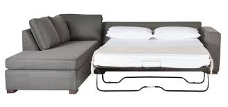 ... Sectional Sofa With Pull Out Bed White And Dark Grey Colours Four  Pillows With Two Different ...