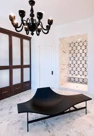 modern black bathroom lounge with black chandelier