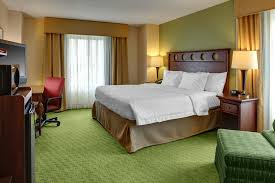 a bed or beds in a room at hampton inn suites tampa ybor city downtown