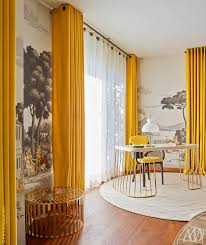 goldenrod curtains and chair in a muraled room luxury furniture exclusive design designer furniture