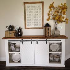 white buffet sliding door console metal basket wood top fall dining room
