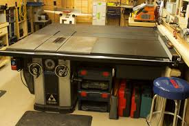 woodshop saws. woodshop delta unisaw with outfeed table. table saw saws