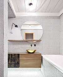 white penny tiles with black grout all over the bathroom give it a texture