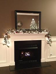 black subway tile fireplace with white mantel and trim black and white fireplace