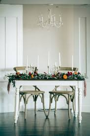the sweetheart table set with candlesticks and beautifully decorated garland