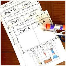 Short vowels discrimination of the short vowels. Free Long And Short Vowel Sounds Worksheets Cut And Paste