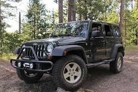 a dark green 2011 jeep wrangler