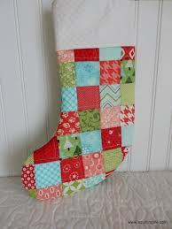 Quilted Christmas Stockings | A Quilting Life - a quilt blog & I used a Thimbleblossoms pattern for my stocking shape...but I used the  Cluck Cluck Sew Christmas Stocking tutorial for assembling my stocking. Adamdwight.com