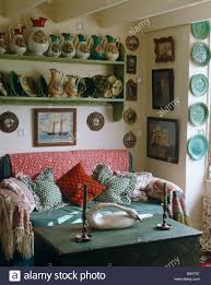 Paisley Sofa display of pottery jugs on green shelves above green velvet sofa 8200 by xevi.us