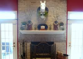 stunning brick wall laminated mantel fireplace design featuring white concrete stained mantel shelves
