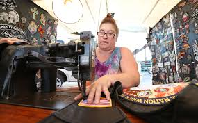miss chrissy the patch queen and owner of bee bad leathers sewed