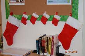 office holiday decor. ccgrs office bulletin board with stockings holiday decor r
