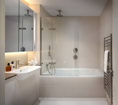 delta tub shower faucet glass shower door mirrored cabinet white vanity white sink faucet recessed lighting