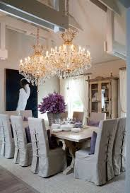 dining room crystal chandelier. Cottage Style Dining Room Illuminated With Double Grand Crystal Chandelier Lights Over Concrete Table : C