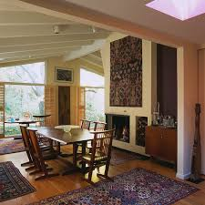 absolutely gorgeous midcentury oriental rug diningroom decoratively plantation shutters with roof line and wood flooring