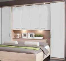 love this bed wardrobes/ storage idea, may do mirror door or the other  colour so it won't look so boring