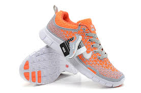 nike shoes logo pictures. 2013 nike free 5.0 running shoes for men in orange gray with white logo pictures