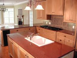 imperial red kitchen with drop in sink cooktop