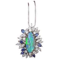fantastic large boulder opal pendant with diamonds and blue sapphires grabsbag ruby lane