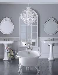 bathrooom chandeliers crystals over tub in bright white bathroom inetrior design bathroom chandeliers