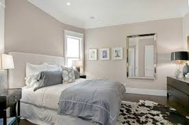 view in gallery taupe bedroom with dark wooden floors