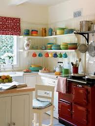 astonishing white kitchen decor ideas with colorful dishware and red kitchen range also white kitchen cabinet plus corner open wall shelves