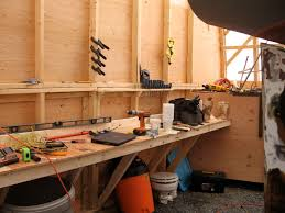 workbench and storage bin in back of shed