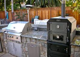 custom design build and finish complete outdoor kitchens including outdoor pizza ovens barbecue islands fire pits and fire tables