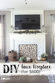 diy faux fireplace for under 600 the big reveal faux fireplace fireplaces and fireplace entertainment centers