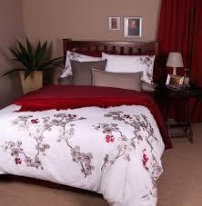 the oriental duvet cover with its delicate cherry blossom details will make you feel like a geisha in japan make a statement with red pops of colour and