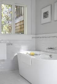 san francisco daltile subway tile white with metal towel bars bathroom transitional and wall art monochromatic