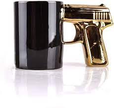 The gun handle mug combines the much needed calm of drinking coffee during a hectic day at the office with the aggression of fantasizing about pointing a firearm at your boss. Amazon Com Sikoo Skull Gun Mug Pistol Mug Skull Cup 3d Ceramic Coffee Mug Beer Mug Gift For Men 14 Oz Black Skull Black Gold Kitchen Dining