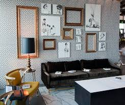 view in gallery unique living room uses unframed sketches and empty picture frames as snazzy decorative pieces from