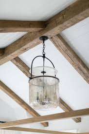 industrial farmhouse lighting. interesting glass pendant light fixture hanging from rustic beams industrial farmhouse lighting g