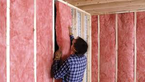 gently press the insulation into the opening between the wall studs