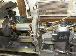 drill press metal lathe. shaft is an odd size and too big for the drill press pulley. so it was chucked up in lathe. bearing worked well with steady rest. metal lathe