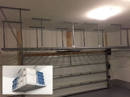 hanging shelves over garage door unforgettable storage systems
