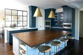 large butcher block island butcher block kitchen island with brass pendants and round stools