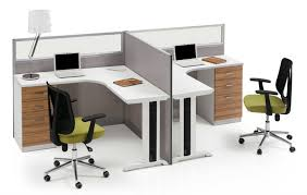 corner workstation for two people with divider and filing drawers a table  lamp two units of