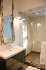 Wonderful Ikea Bathroom Vanities In A Modern Bathroom With Tall West Elm Mirrors