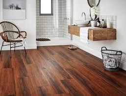 modern minimalist bathroom design with dark floating vinyl plank flooring over concrete white wall interior color diy vintage wood vanity and dirty