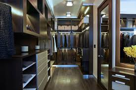 masculine walk-in closet deisgn in only dark tones