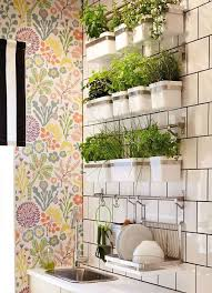 use any wall storage system to create a planter for an herb garden indoors this one is from ikea they have a bunch of diffe styles of containers to