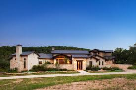 hill country house plans grass stones roof door windows wall pathway plants trees lighting wood