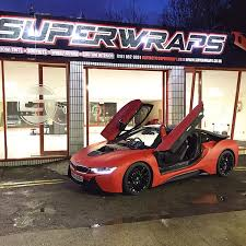 bmw i8 black and red. matte red with carbon roof and gloss black wheels bmw i8