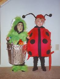 such a fun diy costume oscar the grouch costume made by cutting off bottom of plastic trash can and stapling shoulder straps pinned green fur