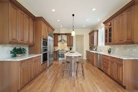 Lovely Long Kitchen With Counters And Cabinets Lining Three Walls. Very Narrow And Long  Island Runs Nice Design