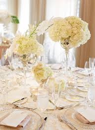 glass decorations for weddings. round wedding table with rosette linen, mercury glass vessels hydrangea and orchid flowers decorations for weddings