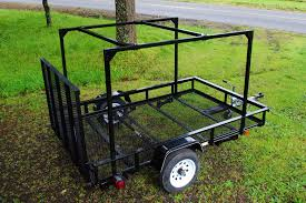 here is a utility trailer with a diy no weld trailer rack installed the trailer rack is a tad over tall it will be getting a roof top tent shortly